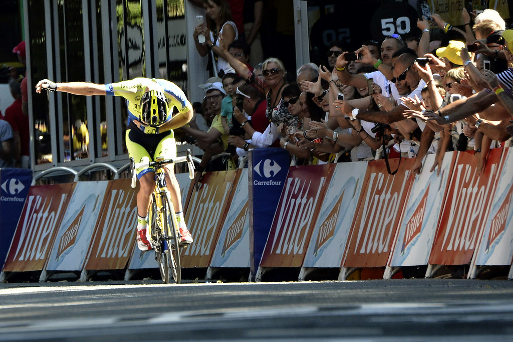 . Australia\'s Michael Rogers celebrates before crossing the finish line at the end of the 237.5 km sixteenth stage of the 101st edition of the Tour de France cycling race on July 22, 2014 between Carcassonne and Bagneres-de-Luchon, southwestern France.  AFP PHOTO / JEFF PACHOUDJEFF PACHOUD/AFP/Getty Images
