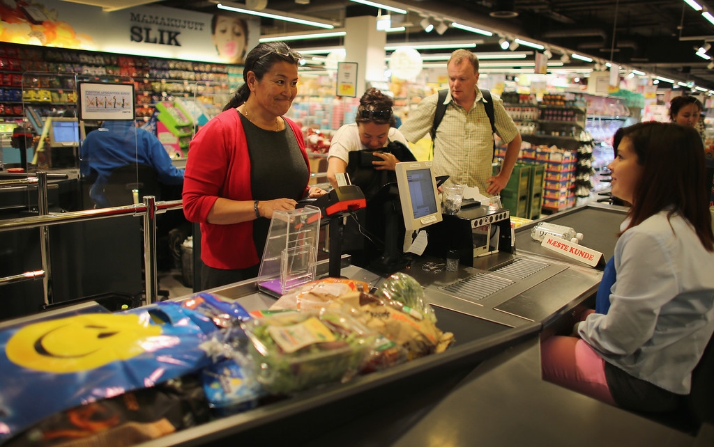. Premier Aleqa Hammond, the leader of Greenlands Parliament (L) shops for food in the grocery store on July 29, 2013 in Nuuk, Greenland.  (Photo by Joe Raedle/Getty Images)