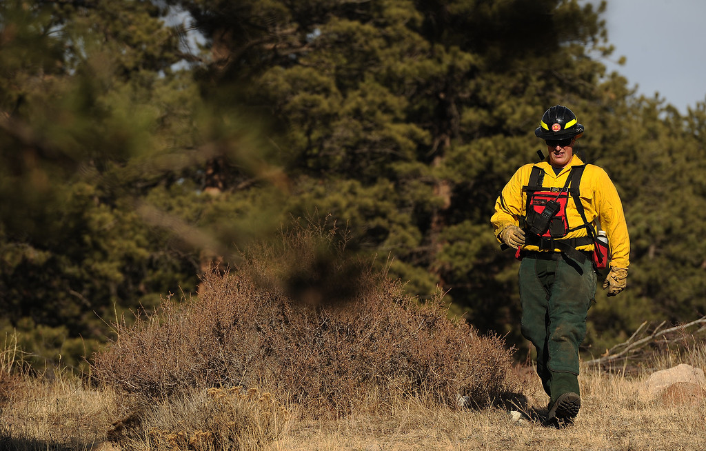 . Wildland firefighters Mitch Sprague,  from Lafayette Fire,  arrives to clear brush and debris from the Moraine Park Vistor\'s Center to protect the structure just in case the fire reaches the building on December 2nd, 2012. The Fern Lake Fire, which has been burning in Rocky Mountain National Park since October, kicked up yesterday and forced the evacuation of hundreds of homes east of the fire. Helen H. Richardson, The Denver Post