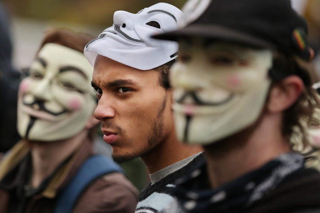 ". People participate in a march to the U.S. Captiol during the ""Million Mask March\""  November 5, 2013 in Washington, DC. Organized by members of Anonymous, WikiLeaks, The Pirate Party, Occupy Wall Street and other hacktivist movements, demonstrators marched on political landmarks and institutions around the world on Guy Fawkes Day. (Photo by Chip Somodevilla/Getty Images)"