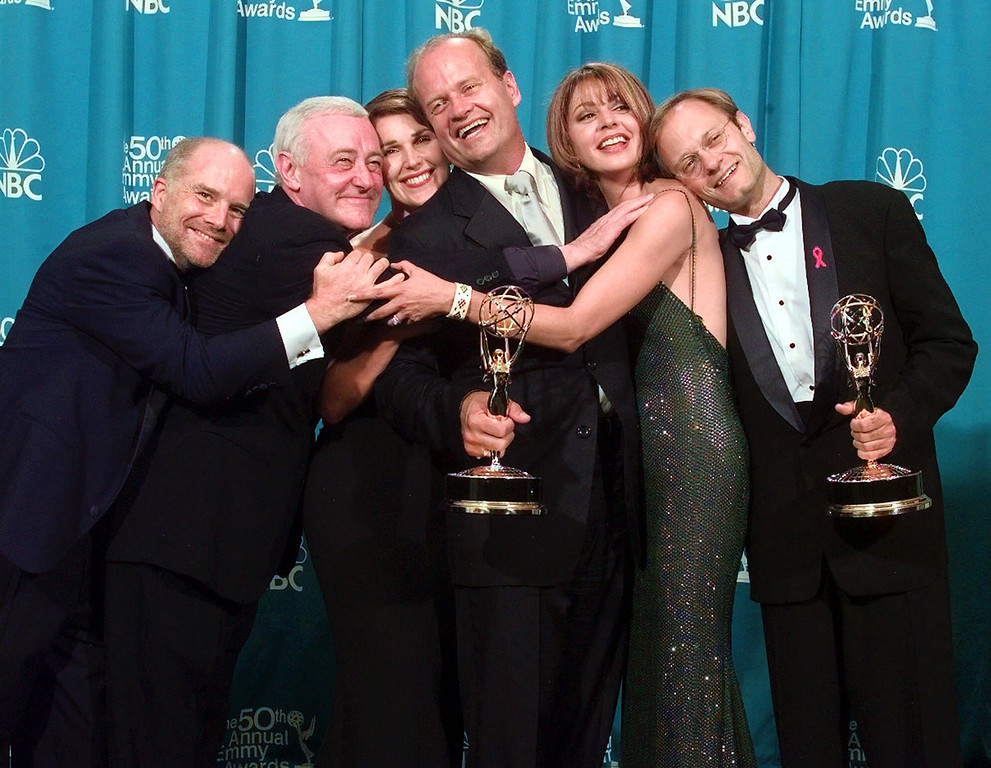 ". Cast members of ""Frasier,\"" winner of the Emmy for Outstanding Comedy Series, have a group hug backstage  at the 50th Annual Primetime Emmy Awards at the Shrine Auditorium in Los Angeles, Sunday, Sept. 13, 1998. From left are Dan Butler, John Mahoney, Peri Gilpin, Kelsey Grammer, Jane Leeves and David Hyde Pierce. Grammer and Pierce also won Emmys. (AP Photo/Reed Saxon)"