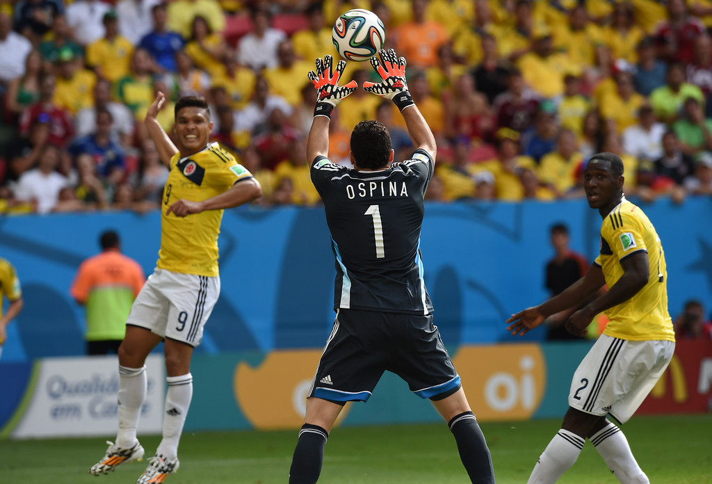 . Colombia\'s goalkeeper David Ospina catches the ball during a Group C football match between Colombia and Ivory Coast at the Mane Garrincha National Stadium in Brasilia during the 2014 FIFA World Cup on June 19, 2014. AFP PHOTO / PEDRO UGARTE/AFP/Getty Images