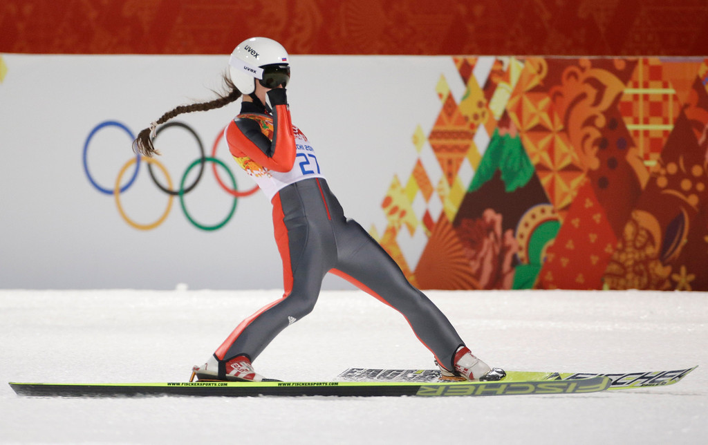 . Russia\'s Irina Avvakumova reacts after her first attempt during the women\'s normal hill ski jumping final at the 2014 Winter Olympics, Tuesday, Feb. 11, 2014, in Krasnaya Polyana, Russia. (AP Photo/Gregorio Borgia)