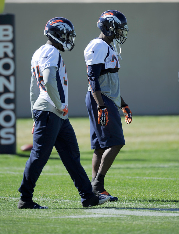 . Denver Broncos cornerback Kayvon Webster (36) and cornerback Champ Bailey (24) of the Denver Broncos head to drills during practice September 25, 2013 at Dove Valley. (Photo by John Leyba/The Denver Post)