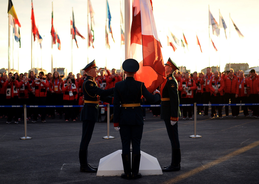 . The Canadian flag is hoisted during the Canadian team\'s welcoming ceremony at the Amphitheater Square in Sochi on February 4, 2014 ahead of the 2014 Sochi Winter Olympics.  AFP PHOTO / ANDREJ ISAKOVIC/AFP/Getty Images