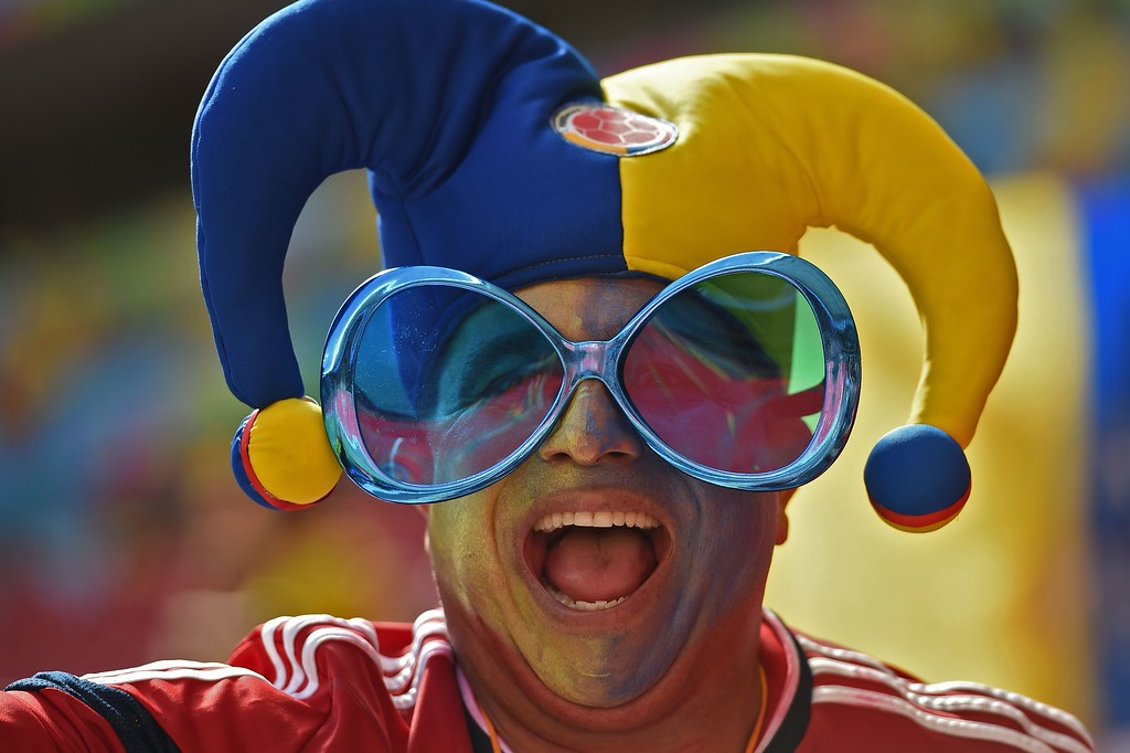 . Colombia\'s fan cheers before a Group C football match between Colombia and Ivory Coast at the Mane Garrincha National Stadium in Brasilia during the 2014 FIFA World Cup on June 19, 2014. AFP PHOTO / PEDRO  UGARTE/AFP/Getty Images