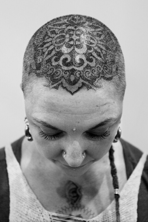 . Tracey from \'Skintastic\' shows off her new head tattoo by artist Anthony Orsatti during The Australian Tattoo & Body Art Expo at the Royal Hall of Industries, Moore Park on March 8, 2013 in Sydney, Australia. The annual three day event showcases some of Australia\'s best tattoo and body artists and is open to enthusiasts March 8-10.  (Photo by Lisa Maree Williams/Getty Images)