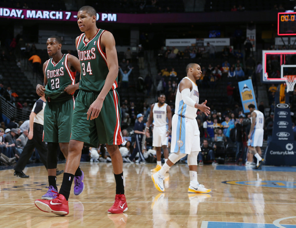 . Milwaukee Bucks forwards Giannis Antetokounmpo, front, of Greece, and Khris Middleton head off the court after the Denver Nuggets\' 110-100 victory over the Bucks in an NBA basketball game in Denver on Wednesday, Feb. 5, 2014. (AP Photo/David Zalubowski)