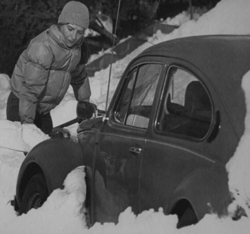 . Digging Out -- Florece Barrier returned to Denver Wednesday after a trip to Texas to find her car buried in snow in front of her house. Denver continues to dig out with snow forecast for later in the week. 1982. Credit: AP Laserphoto. Denver Post Library Archive
