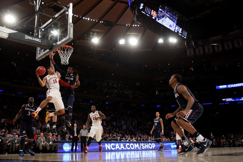 . Naz Long #15 of the Iowa State Cyclones looks to pass from under the basket against DeAndre Daniels #2 of the Connecticut Huskies during the regional semifinal of the 2014 NCAA Men\'s Basketball Tournament at Madison Square Garden on March 28, 2014 in New York City.  (Photo by Bruce Bennett/Getty Images)
