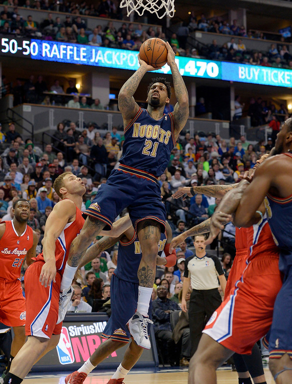 . Denver Nuggets forward Wilson Chandler (21) god up for an easy basket as Los Angeles Clippers forward Blake Griffin (32) looks on during the first quarter March 17, 2014 at the Pepsi Center. (Photo by John Leyba/The Denver Post)