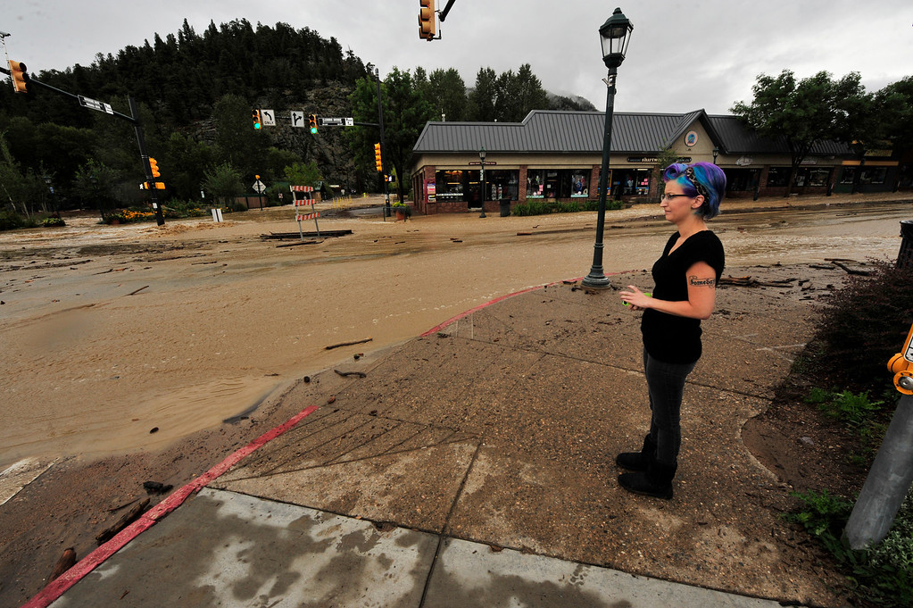 . A local has a hard time looking at the destruction on Elkhorn Avenue on Friday, September 13, 2013. Most of the businesses in the downtown section of Elkhorn Avenue suffered some damage from the historic flood. Walt Hester/Estes Park Trail-Gazette