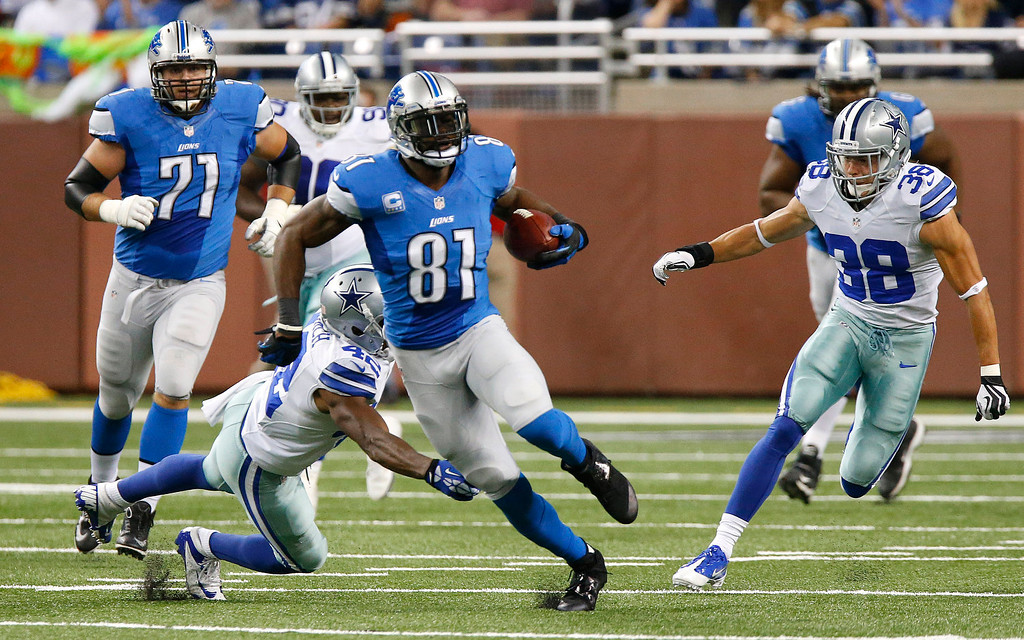 . Detroit Lions wide receiver Calvin Johnson (81) breaks free for a 87-yard reception against the against the Dallas Cowboys in the first half of an NFL football game in Detroit, Sunday, Oct. 27, 2013. (AP Photo/Duane Burleson)