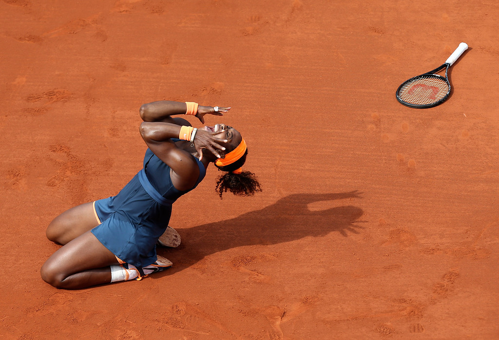 . Serena Williams, of the U.S, celebrates as she defeats Russia\'s Maria Sharapova during the Women\'s final match of the French Open tennis tournament at the Roland Garros stadium Saturday, June 8, 2013 in Paris. Williams won 6-4, 6-4. (AP Photo/David Vincent)