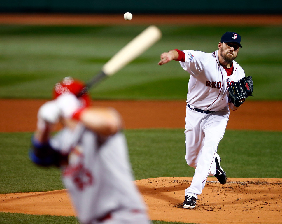 . Boston Red Sox starting pitcher John Lackey throws during the first inning of Game 2 of baseball\'s World Series against the St. Louis Cardinals Thursday, Oct. 24, 2013, in Boston. (AP Photo/Jared Wickerham, Pool)