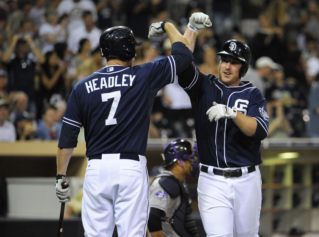 . SAN DIEGO, CA - SEPTEMBER 7:   Jedd Gyorko #9 of the San Diego Padres, right, is congratulated by Chase Headley #7 after he hit a solo home run during the eighth inning of a baseball game against the Colorado Rockies at Petco Park on September 7, 2013 in San Diego, California.  The Padres won 2-1. (Photo by Denis Poroy/Getty Images)