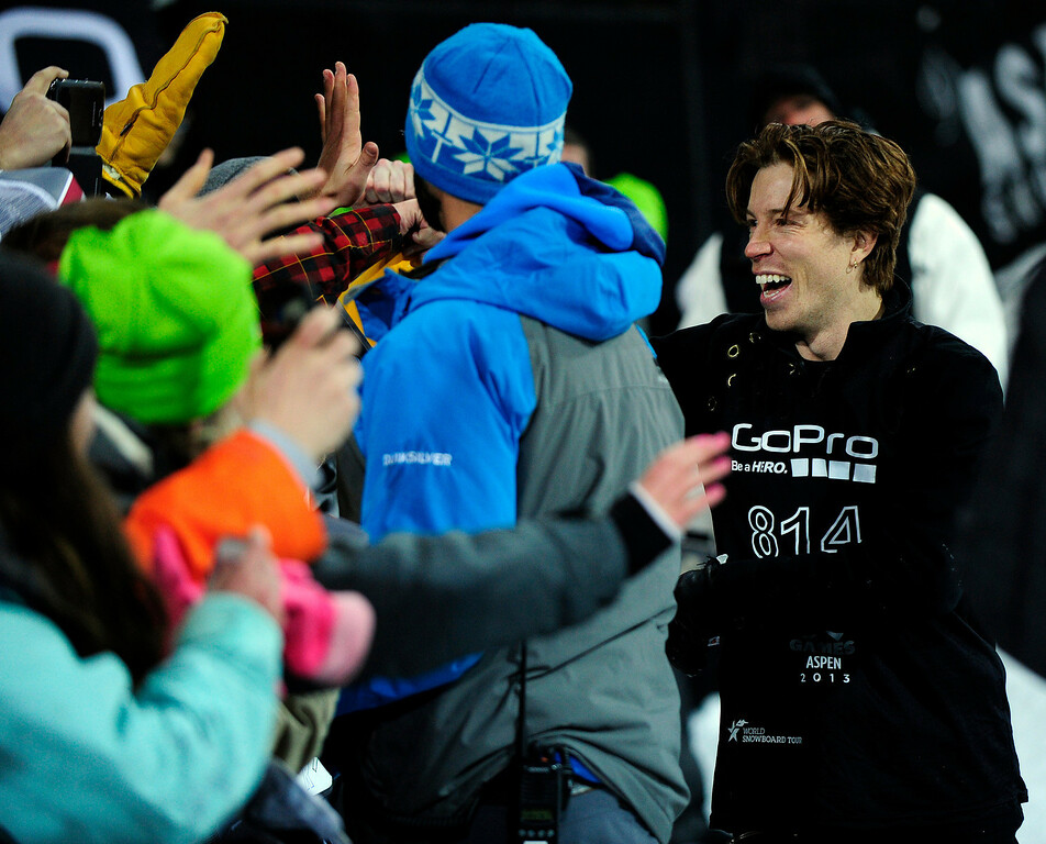 . ASPEN, CO - JANUARY 27: Shaun White celebrates with the crowd after winning gold in the men\'s superpipe final at Winter X Games Aspen 2013 at Buttermilk Mountain on Jan. 27, 2013, in Aspen, Colorado. (Photo by Daniel Petty/The Denver Post)
