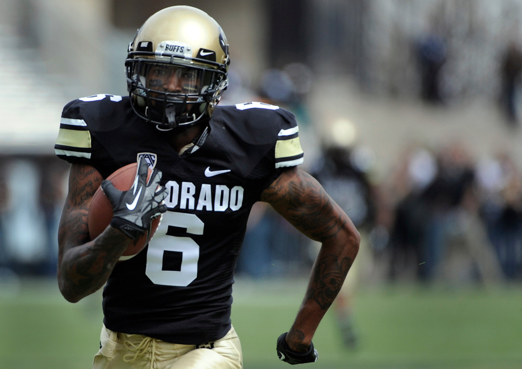 . BOULDER, CO.- APRIL13: Paul Richardson outpaces his teammates in to the end zone for six points. The University of Colorado football team hosts its spring football game at Folsom Field under the direction of new head coach Mike MacIntyre. (Photo By Kathryn Scott Osler/The Denver Post)