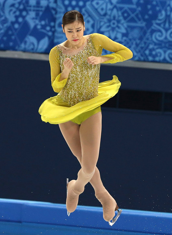 . Kim Yuna of South Korea performs during the Ladies Short Program Figure Skating event at the Iceberg Skating Palace during the Sochi 2014 Olympic Games, Sochi, Russia, 19 February 2014.  EPA/BARBARA WALTON