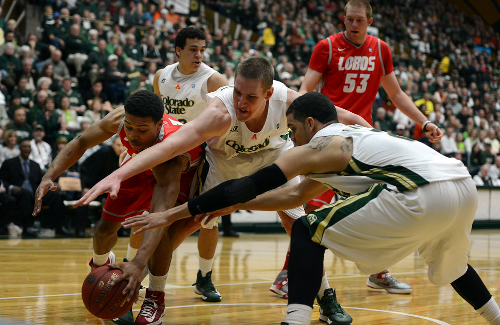 . Fort COLLINS, CO. - FEBRUARY 23: New Mexico Cleveland Thomas battles for a loose ball with CSU Colton Iverson and Daniel Bejarano during first half action at Moby Arena in Fort Collin, CO February  24, 2013. The Colorado State Rams lost to the New Mexico Lobos 91-82. (Photo By Craig F. Walker/The Denver Post)