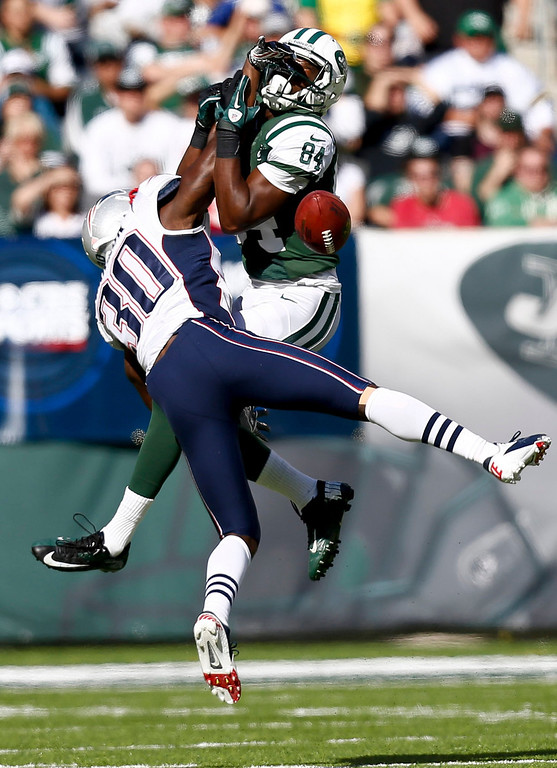 . Duron Harmon #30 of the New England Patriots breaks up a pass intended for Stephen Hill #84 of the New York Jets during their game at MetLife Stadium on October 20, 2013 in East Rutherford, New Jersey.  (Photo by Jeff Zelevansky/Getty Images)