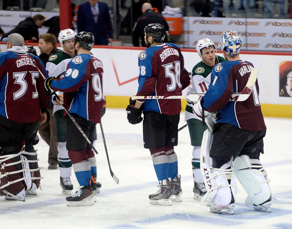 . The Colorado Avalanche shake hands with the Minnesota Wild after the Wild defeated the Avalanche 5 to 4. (Photo by John Leyba/The Denver Post)