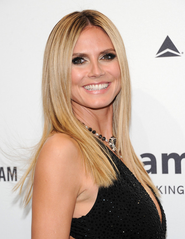. Television personality Heidi Klum attends amfAR\'s New York gala at Cipriani Wall Street on Wednesday, Feb. 6, 2013 in New York. (Photo by Evan Agostini/Invision/AP)