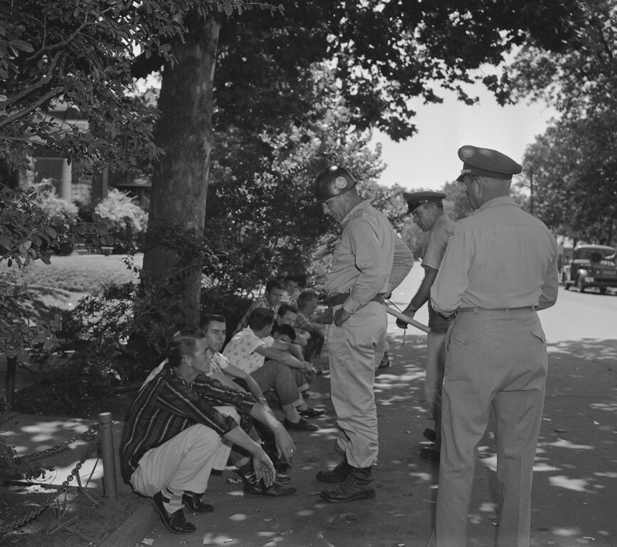 . Teenagers who heckled passersby at Central High School in Little Rock, Ark., are held by National Guardsmen and told to either quiet down or be escorted from the scene, Sept. 5, 1957.  (AP Photo/William P. Straeter)