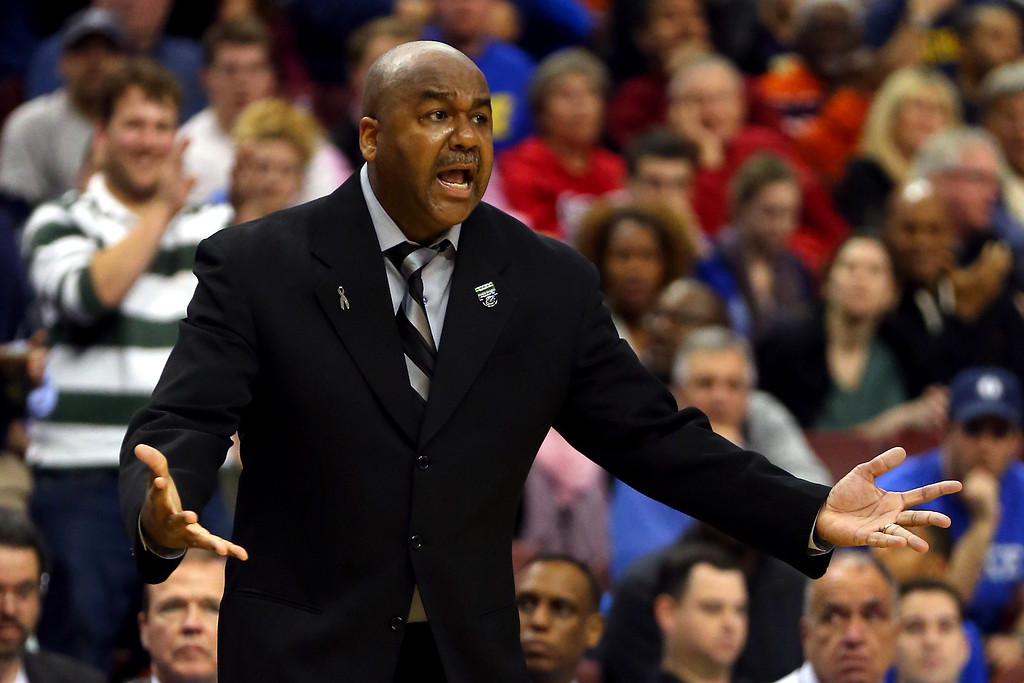 . PHILADELPHIA, PA - MARCH 22:  Head coach John Thompson III of the Georgetown Hoyas reacts in the second half against the Florida Gulf Coast Eagles during the second round of the 2013 NCAA Men\'s Basketball Tournament at Wells Fargo Center on March 22, 2013 in Philadelphia, Pennsylvania.  (Photo by Elsa/Getty Images)