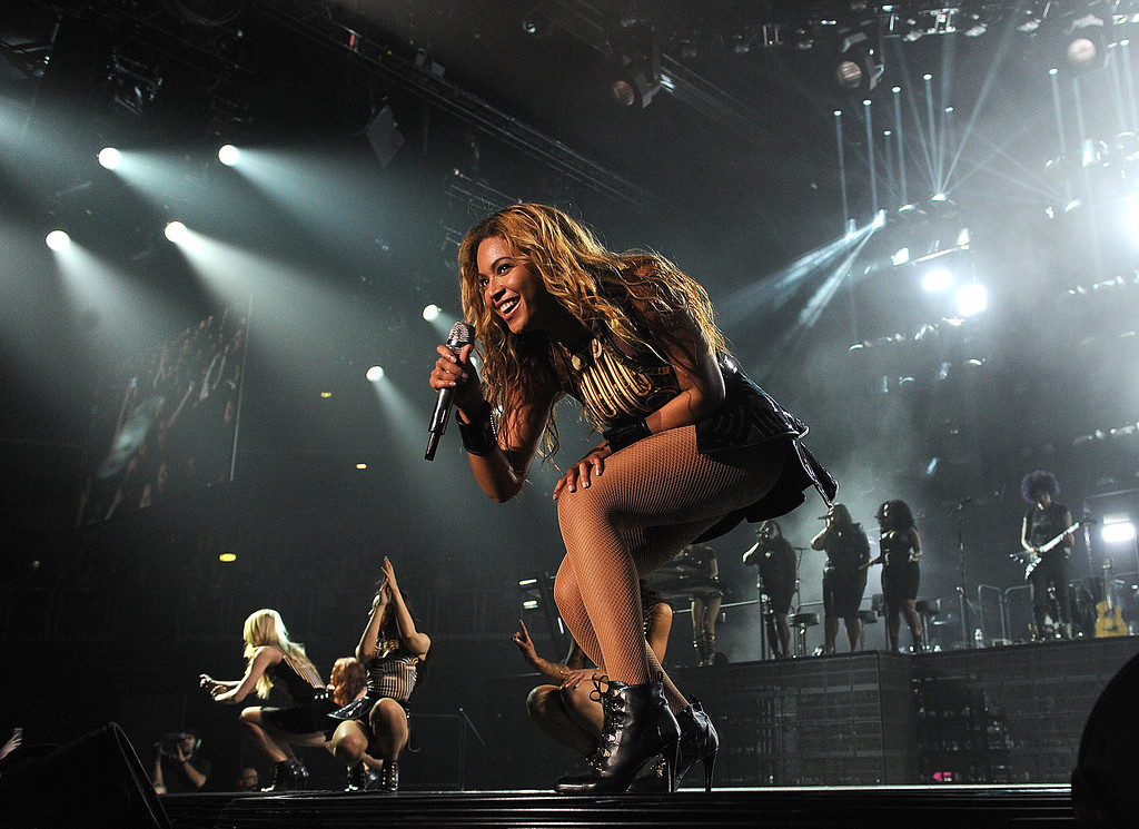 """. Singer Beyonce performs on her \""""Mrs. Carter Show World Tour 2013\"""", on Wednesday, April 17, 2013 at the Arena Zagreb in Zagreb, Croatia. Beyonce is wearing a gold and black one-piece with skirt by designer David Koma. (Photo by Frank Micelotta/Invision for Parkwood Entertainment/AP Images."""