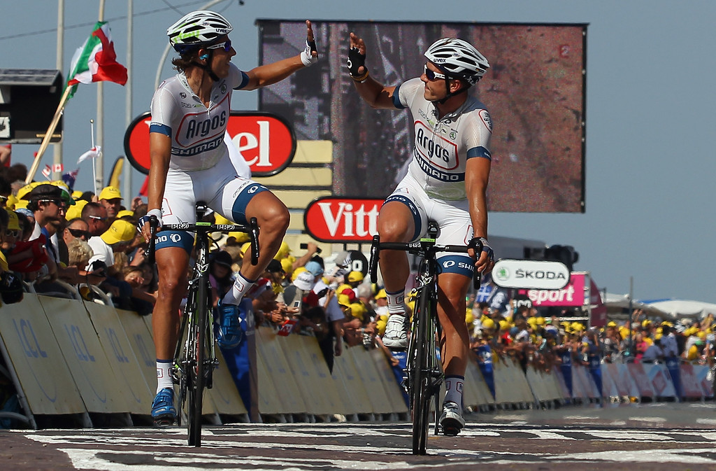 . Koen De Kort, left, of the Netherlands and teammate John Degenkolb of Germany riding for Team Argos-Shimano celebrate as they cross the finish line after their teammate Marcel Kittel of Germany won stage ten of the 2013 Tour de France, a 197KM road stage from St-Gildas-des-Bois to Saint Malo, on July 9, 2013 in St Malo, France.  (Photo by Doug Pensinger/Getty Images)