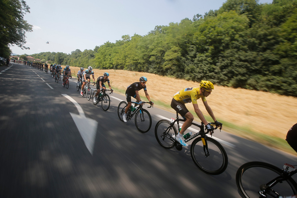 . Team Sky with Christopher Froome of Britain, wearing the overall leader\'s yellow jersey, leads the pack during the fourteenth stage of the Tour de France cycling race over 191 kilometers (119.4 miles) with start in in Saint-Pourcain-sur-Sioule and finish in Lyon, central France, Saturday July 13 2013. (AP Photo/Laurent Cipriani)