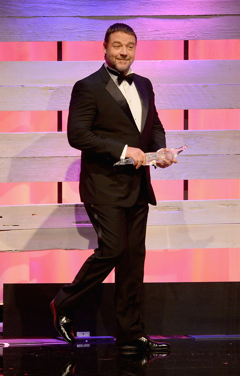 . Presenter Russell Crowe onstage during the 15th Annual Costume Designers Guild Awards with presenting sponsor Lacoste at The Beverly Hilton Hotel on February 19, 2013 in Beverly Hills, California.  (Photo by Jason Merritt/Getty Images for CDG)