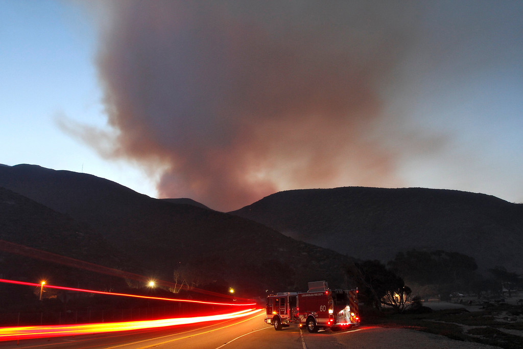 . A fire engine is parked on Pacific Coast Highway as the Springs Fire burns in the hills at Point Mugu State Park, May 3, 2013. REUTERS/Jonathan Alcorn