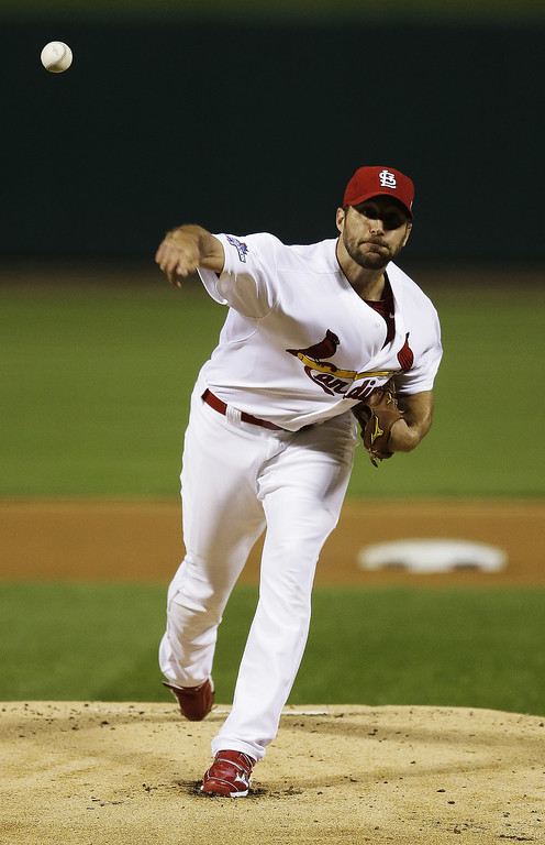 . Adam Wainwright #50 of the St. Louis Cardinals pitches against the Pittsburgh Pirates during Game Five of the National League Division Series at Busch Stadium on October 9, 2013 in St Louis, Missouri.  (Photo by Jeff Roberson-Pool/Getty Images)