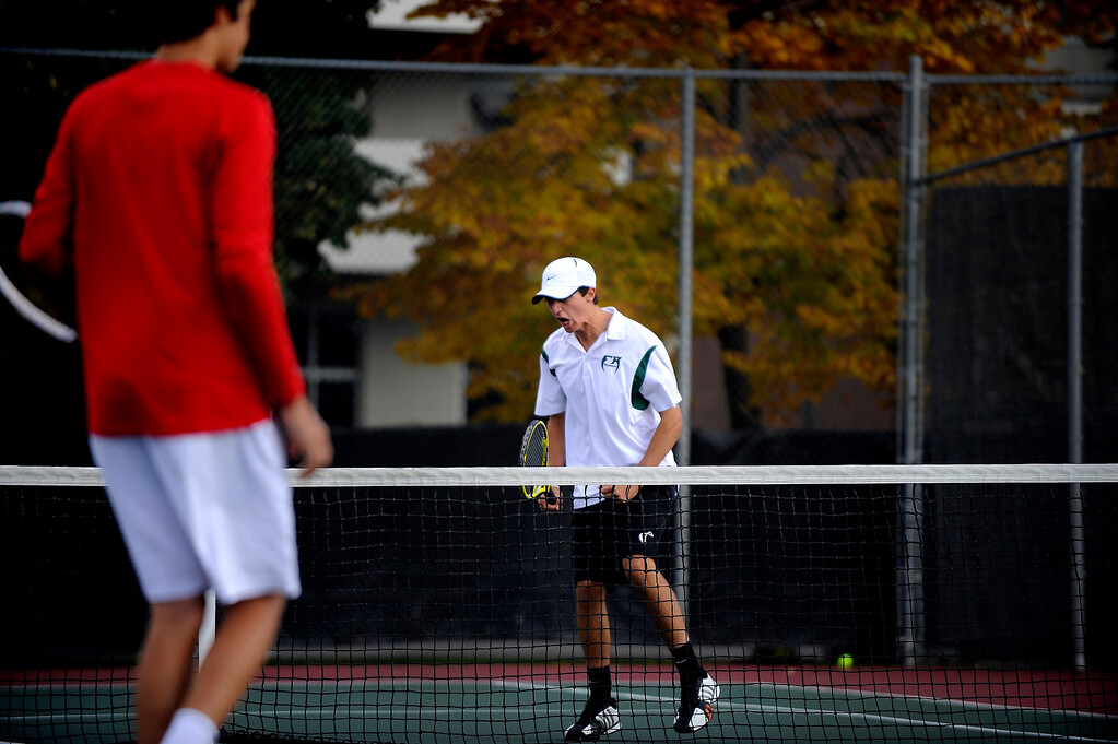 . DENVER, CO. - OCT 12:   Kevin Schultz of Fossil Ridge reacts to a play during his doubles match against Regis Jesuit opponents on the final day of the 5A Boys\' Tennis Championships.  (Photo By Erin Hull/The Denver Post)