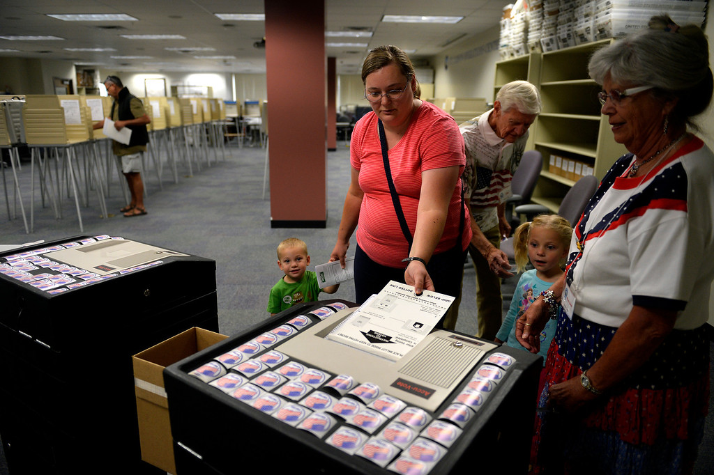 . COLORADO SPRINGS, CO. - September 10: 1 year old Heber Wilson and his 4 year old sister Mary Emma watch as their mother Alison casts her ballot during the recall vote for Senate President John Morse at the El Paso Citizens Service Center September 10, 2013 Colorado Springs, Colorado. (Photo By Joe Amon/The Denver Post)