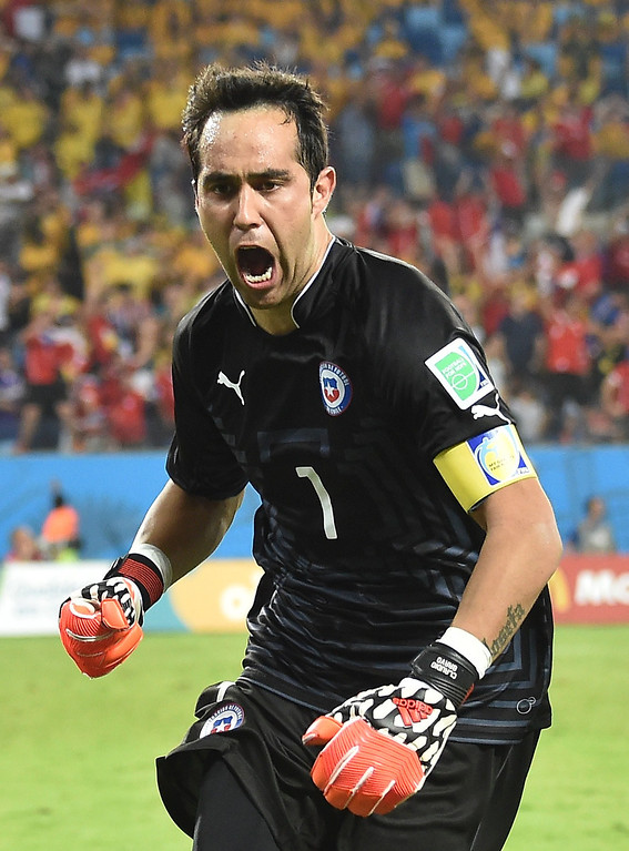 . Chile\'s goalkeeper Claudio Bravo celebrates after his team scored at the end of a Group B football match between Chile and Australia at the Pantanal Arena in Cuiaba during the 2014 FIFA World Cup on June 13, 2014.     AFP PHOTO / LUIS ACOSTA