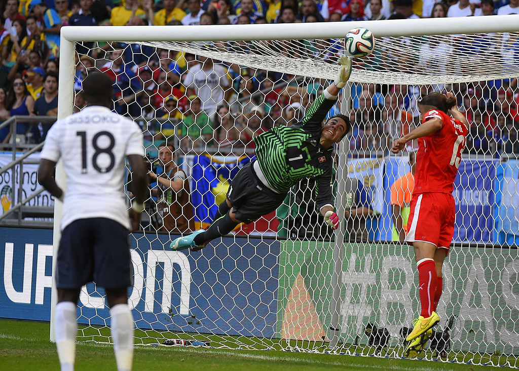 . Switzerland\'s goalkeeper Diego Benaglio fails to stop a ball shot by France\'s forward Olivier Giroud during a Group E football match between Switzerland and France at the Fonte Nova Arena in Salvador during the 2014 FIFA World Cup on June 20, 2014. FABRICE COFFRINI/AFP/Getty Images