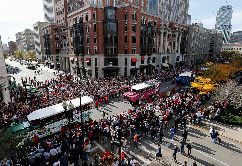 . Duck Boats carrying Boston Red Sox players make their way down Boylston Street during a victory parade celebrating the team\'s third World Series title since 2004, Saturday, Nov. 2, 2013, in Boston. (AP Photo/Michael Dwyer)