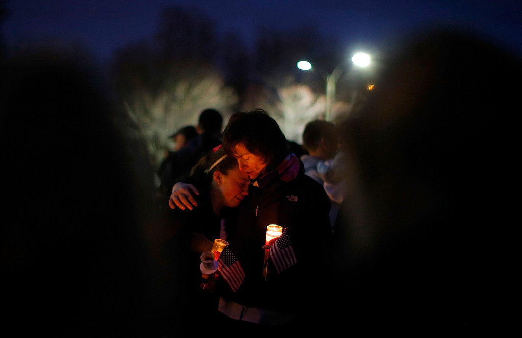 ". Local residents hug at a candle light vigil in the Dorchester neighborhood of Boston, Massachusetts April 16, 2013 where eight-year-old Boston Marathon bombing victim Martin Richard lived. A Little League baseball player, Martin lived in the blue Victorian house in working-class Dorchester - a Boston neighborhood dotted with ""Kids at Play\"" traffic signs and budding trees - with his parents Bill and Denise, sister Jane, 7, and brother Henry, 10. Bill Richard told the world in an email on Tuesday that his son had been killed when bombs exploded at the marathon finish line. Martin\'s mother and sister were seriously injured.    REUTERS/Brian Snyder"