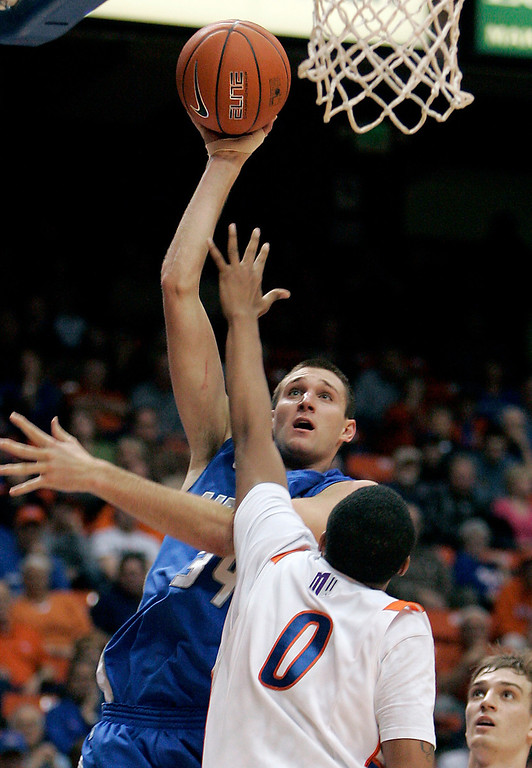 . Air Force\'s Taylor Broekhuis (34) shoots over Boise State\'s Ryan Watkins (0) during the second half of an NCAA college basketball game, Wednesday, Feb. 20, 2013, in Boise, Idaho. Boise State won 77-65. (AP Photo/Matt Cilley)