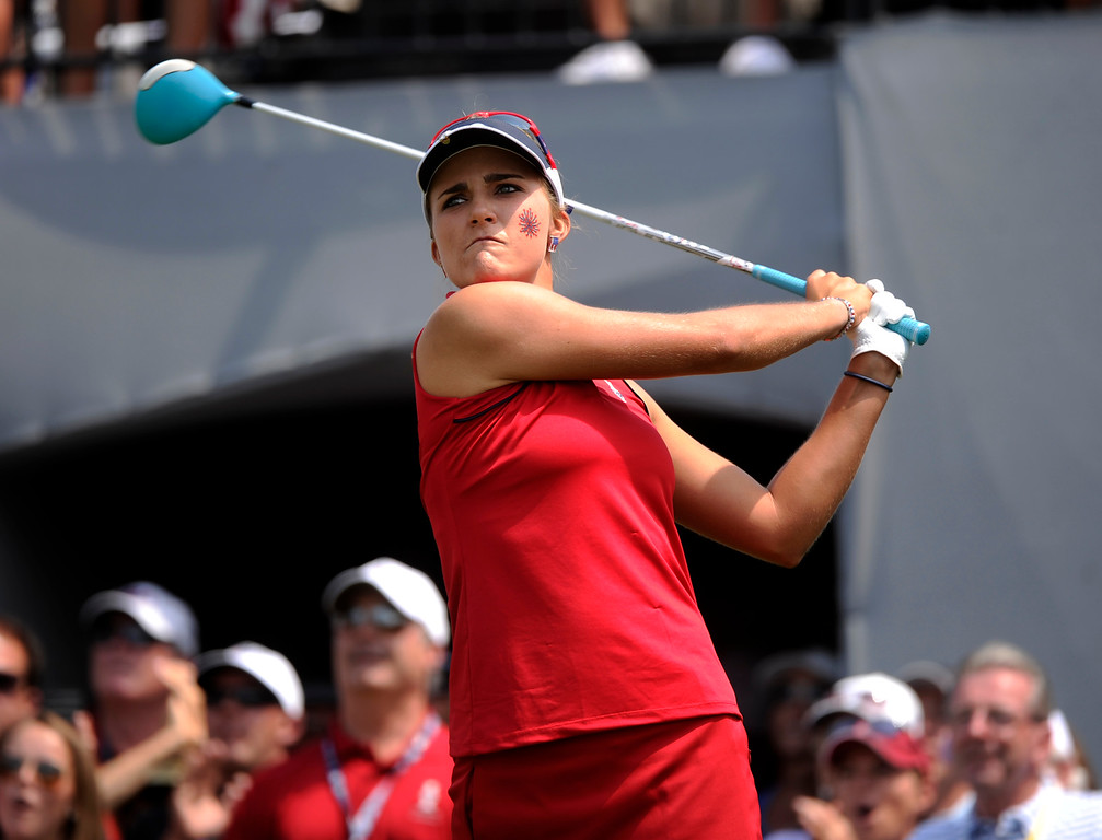 . PARKER, CO. - AUGUST 17: American golfer Lexi Thompson watched her tee shot on the 1st hole Saturday at the Solheim Cup. It was the American Team versus the Europeans as play continued at the Colorado Golf Club Saturday afternoon, August 17, 2013. Photo By Karl Gehring/The Denver Post