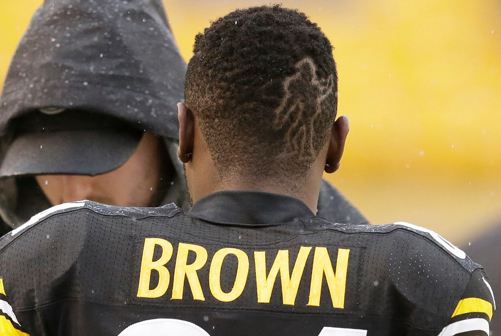 . Pittsburgh Steelers wide receiver Antonio Brown walks along the sidelines with a figure cut into this hair before an NFL football game Cleveland Browns, Sunday, Dec. 29, 2013, in Pittsburgh. (AP Photo/Gene J. Puskar)