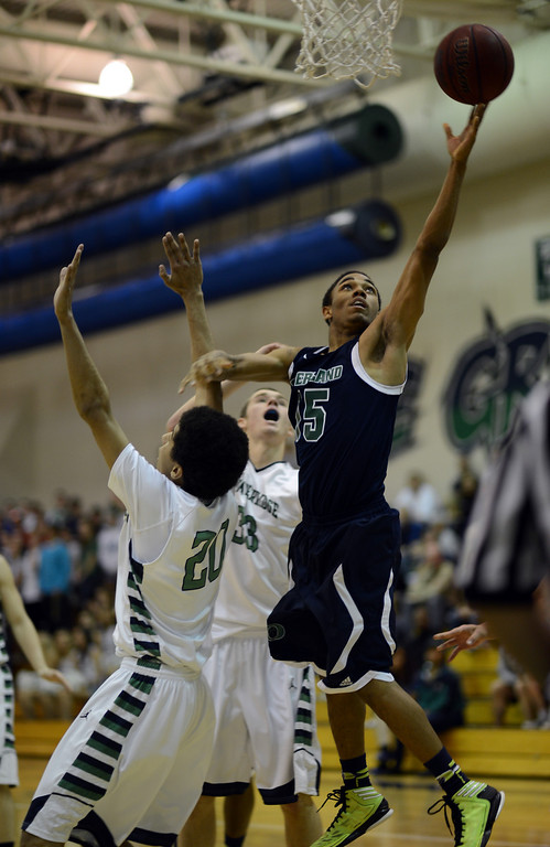 . HIGHLANDS RANCH, CO. - MARCH 02: Austin Conway of Overland High School #15 makes the basket over Keelan Hammonds of ThunderRidge High School #20 during the 2nd round of 5A playoff game at ThunderRidge High School. March 2, 2013. Highlands Ranch, Colorado. ThunderRidge won 67-57. (Photo By Hyoung Chang/The Denver Post)