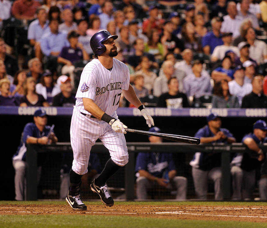 . DENVER, CO. - SEPTEMBER 4: Rockies\' slugger Todd Helton watched as his ball headed for the right field fence for a home run in the second inning. The Colorado Rockies hosted the Los Angeles Dodgers at Coors Field Wednesday night, September 4, 2013.  Photo By Karl Gehring/The Denver Post