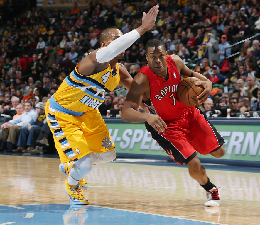 . Toronto Raptors guard Kyle Lowry, right, works ball inside past Denver Nuggets guard Randy Foye in the first quarter of an NBA basketball game in Denver, Friday, Jan. 31, 2014. (AP Photo/David Zalubowski)