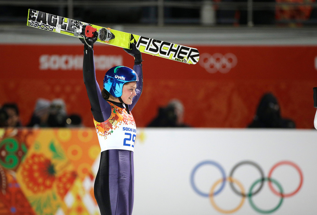 . Germany\'s Carina Vogt celebrates winning the gold during the women\'s normal hill ski jumping final at the 2014 Winter Olympics, Tuesday, Feb. 11, 2014, in Krasnaya Polyana, Russia. (AP Photo/Gregorio Borgia)