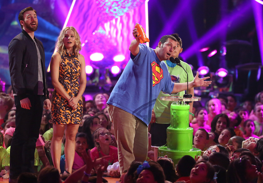 . Adam Sandler accepts the award for favorite movie actor at the 27th annual Kids\' Choice Awards at the Galen Center on Saturday, March 29, 2014, in Los Angeles. (Photo by Matt Sayles/Invision/AP)