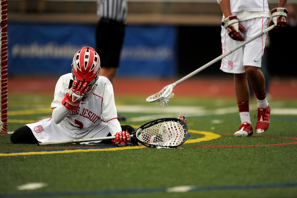 . DENVER, CO - MAY 15: Regis Jesuit sophomore goalie Bret Quartuccio #2 reacts after letting an early goal go by against Arapahoe High School during a CHSAA 5A boys lacrosse semifinal game on May 15, 2013, in Denver, Colorado. Arapahoe won 13-5 to advance to the finals. (Photo by Daniel Petty/The Denver Post)